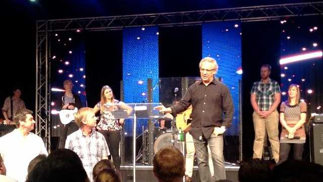 Bill Johnson listens as people tell of being healed at his service at Nexus Church in Brisbane.