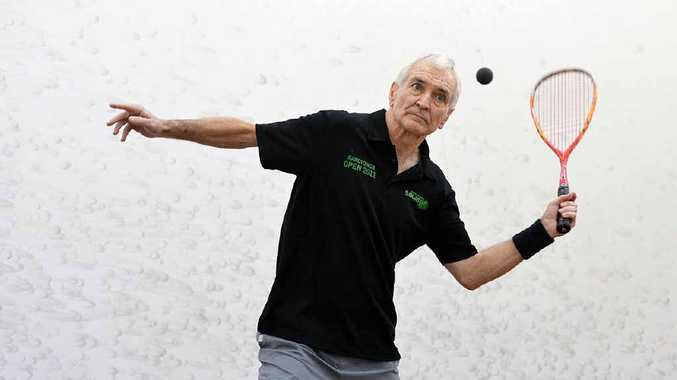 EYEING SUCCESS: Ipswich's long-serving squash player Brian Cook displays the concentration that has secured him so much international glory. Below right: Cook has savoured the world of enjoyment squash has given him.