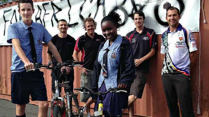 Collecting bikes for Africa are (front) Mackay Christian College students Wesley Bailey and Ndanji Nangoyi and (back) Mackay Christian College's Peter Lister and Corry Cycles staff Craig Larsen, Dylan Alder and Ryan Corry.