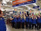 Madeleine Zinn, of customer service, leads some of the Masters staff members in the team chant yesterday ahead of a scheduled August opening for the new Mackay store.