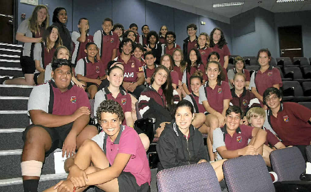 HAPPY FACES: Johnathan Thurston met with a delighted group of local indigenous students on Monday.