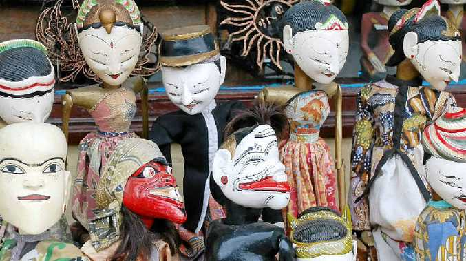 Puppets in front of an antique store in Ubud.