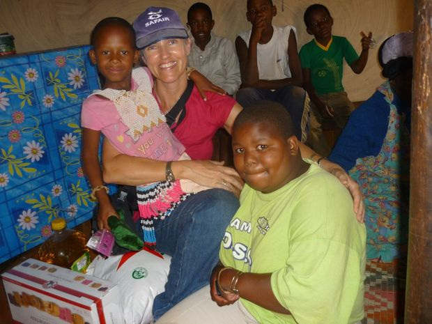 Gillian Gardiner in South Africa with her World Vision sponsor child Awandilie and members of the village. Contributed