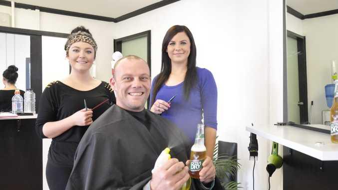 Matt Bingham settles in for relaxing beer... and a haircut.