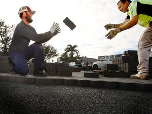 Luke Walker putting his football skills to good use at work, catching a brick thrown by Geoff Byfield.
