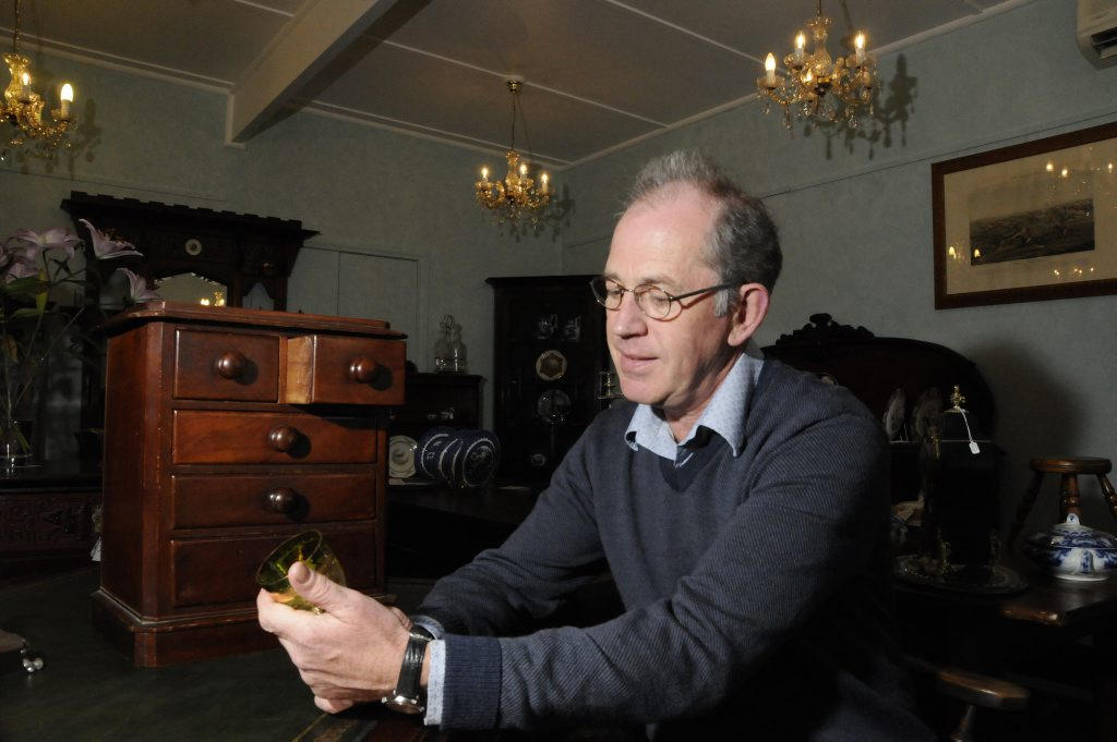 Range Antiques owner Jeremy Green talks about the increasing interest in antiques. Photo: Bev Lacey / The Chronicle