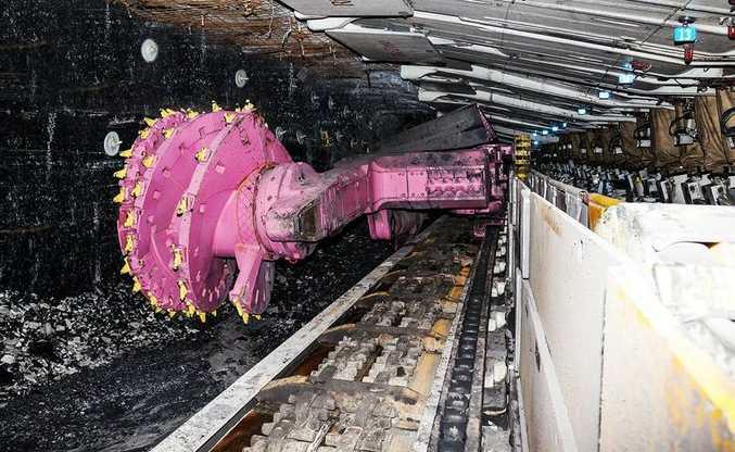 "Rio Tinto's ""longwall shearer"" shaving an underground wall of coal."
