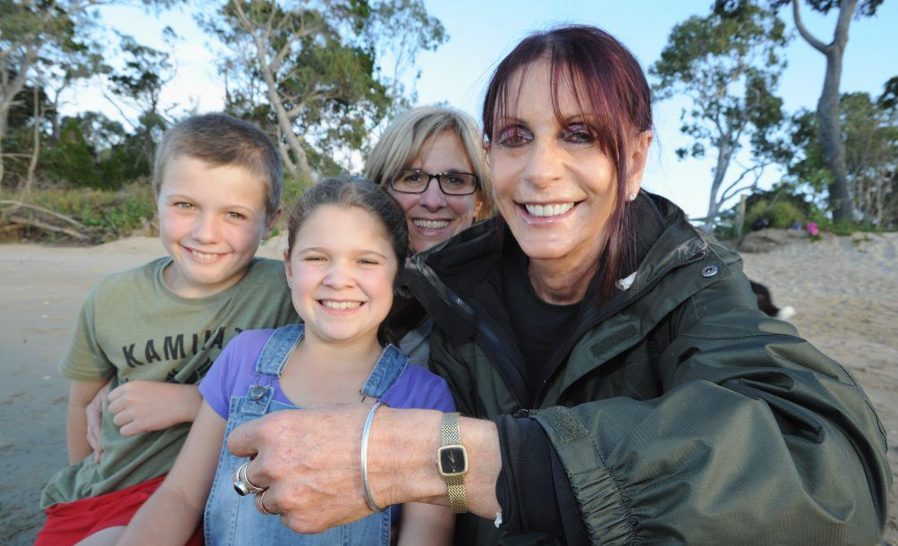 Watch found on Dundowran Beach by 11 yr old Alex Webb and returned to owner after his 9 year old sister Ella recognizes the scent of the owner, Sandi Fletcher. (L) Alex, Ella and Jane Webb and Sandi Fletcher. Photo: Alistair Brightman / Fraser Coast Chronicle