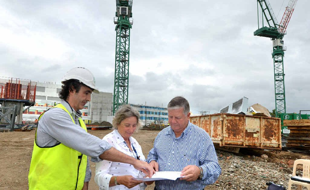 Baulderstone project director Lee Hughes, Mackay Base Hospital redevelopment co-ordinator Kath Ryan and Mackay Hospital and Health Services Board chairman Col Meng inspect work on the next stage of the redevelopment project.