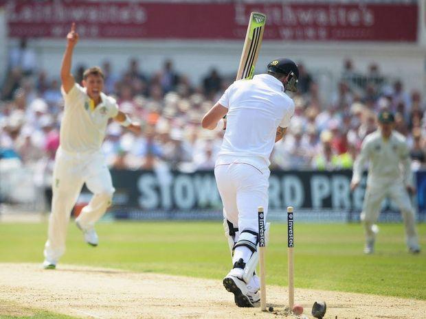 James Pattinson of Australia bowls Kevin Pietersen