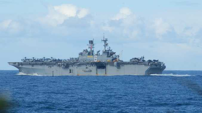 The USS Bonhomme Richard cruises past Caloundra after docking in Brisbane. Photo Bill Hogan