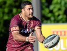 BUSINESS AS USUAL: Justin Hodges offloads during a Queensland training session at Coolum yesterday.