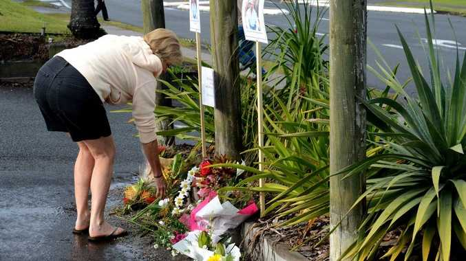 People laying wreaths for Kelvin Kane in the carpark Kingscliff.