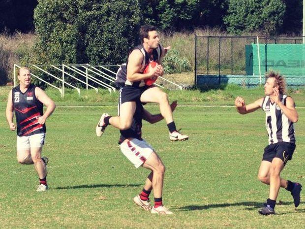 FLYING HIGH: Byron's Joe Ryan marks strongly while team mate Matt Shaw looks on. PHOTO: Scott Anlezark