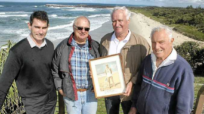 MEMORIES: Captain of the Ballina Lighthouse and Lismore Surf Life Saving Club Andrew Dougherty with veteran lifesavers Richard Crandon, Eoin Johnston and Jack Trevan. Mr Johnston is holding a picture of himself taken in the early 1960s.