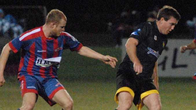Mackay Lions player Tim Curtin (right) runs away from Burdekin's Ryan Mottin in the Northern Club Challenge match.