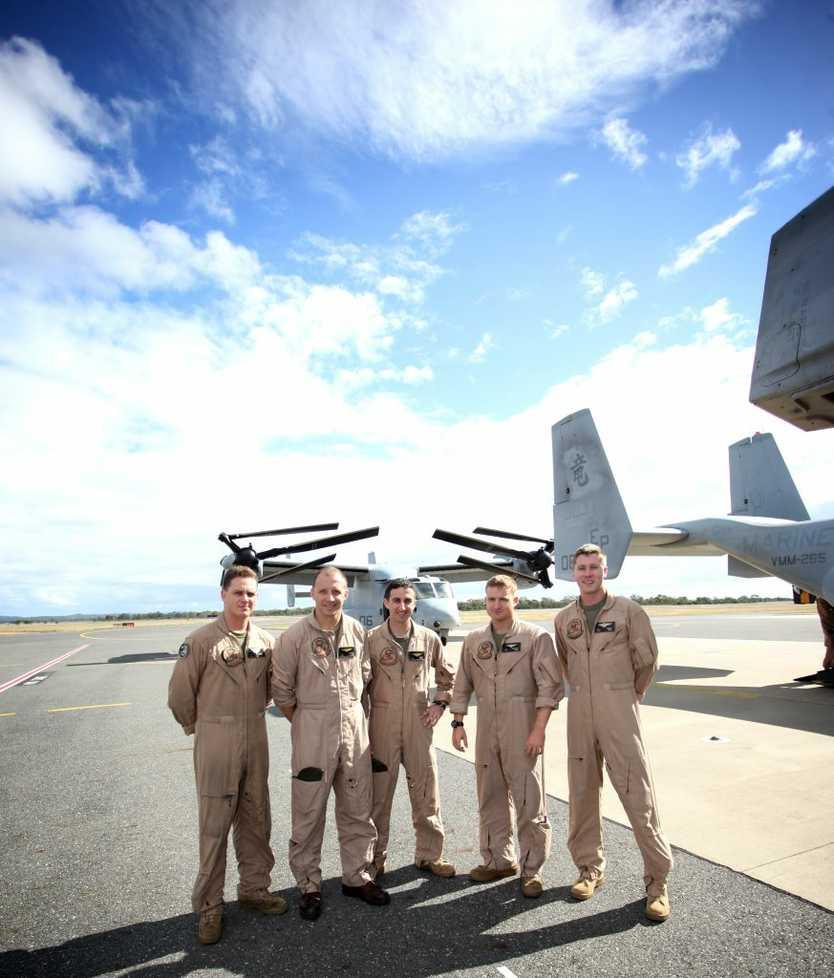 USMC's SGT J.J. Schneider, CAPT C.R. Sherwood, CAPT C.A. Goodman, CAPT J.E. Carpenter and CAPT T.E. Keeney at Rockhampton Airport with two V-22 Ospreys. Photo Allan Reinikka / The Morning Bulletin