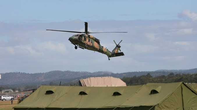 Activity such as helicopters and other defence aircraft taking off and landing at the Rockhampton Airport due to Talisman Saber 2013 has attracted the attention of two curious crocodiles.