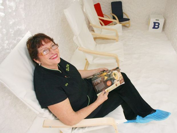Kitty Wren sits in the new salt cave at her Skin Deep Rejuvenation Centre. Photo: Chris Ison / The Morning Bulletin