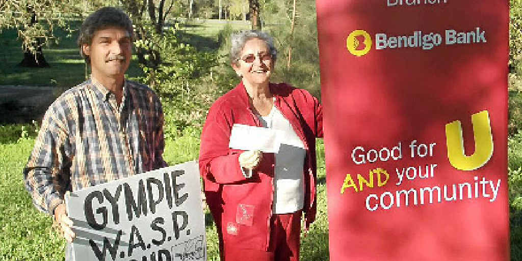 Jeff Douwes from the Gympie Water, Air and Soil Protection Group with Bendigo Bank Gympie branch president Elaine Thompson.