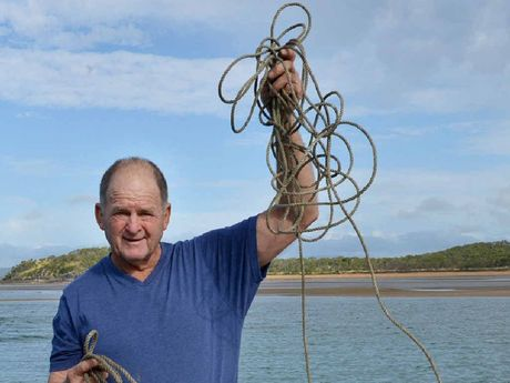 Commercial crabber Greg Sichter with the remnants of some of his crab pots, which have been continuously raided.