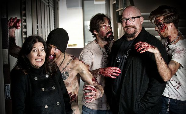 QUT academics Dr Debra Polson and Dr Tim Milfull are running a public zombie research seminar about the continued popularity of zombies in pop culture. Also pictured from left to right are zombies Darryl Burns, Chris Earl and Andrew Watt.