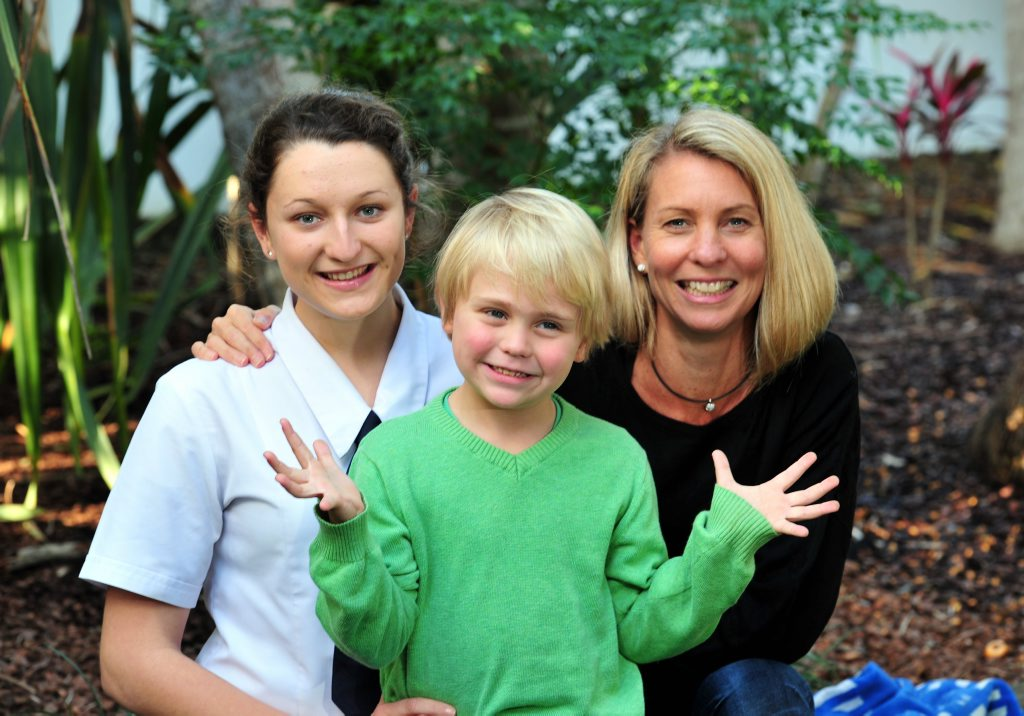 Image for sale: 5 year old Jesse Forsyth with his Mum Caroline (right) and his rescuer India O`Connor happily at home in Noosa after his big adventure.