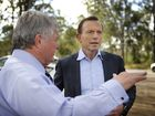 Opposition Leader Tony Abbott and Federal Member for Flynn Ken O'Dowd face media on the Bruce Hwy at Benaraby.