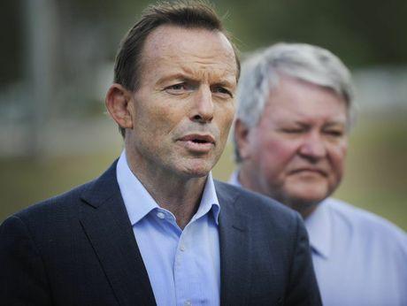 Opposition Leader Tony Abbott and Federal Member for Flynn Ken O'Dowd face media on the Bruce Hwy at Benaraby.