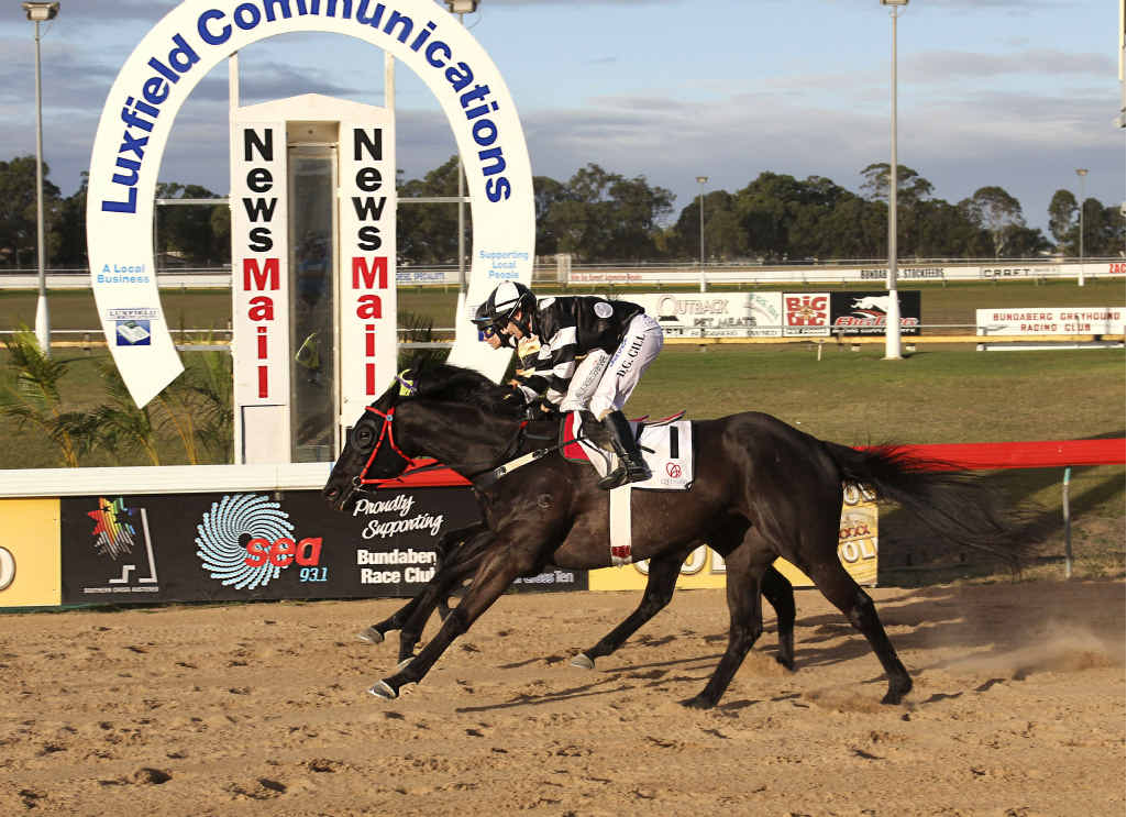 Desiree Gill on Unique Fuse beats Billie Rose Derbyshire on Frenardi by a hair in the Lightning Handicap over 1090m at Bundaberg Race Club.