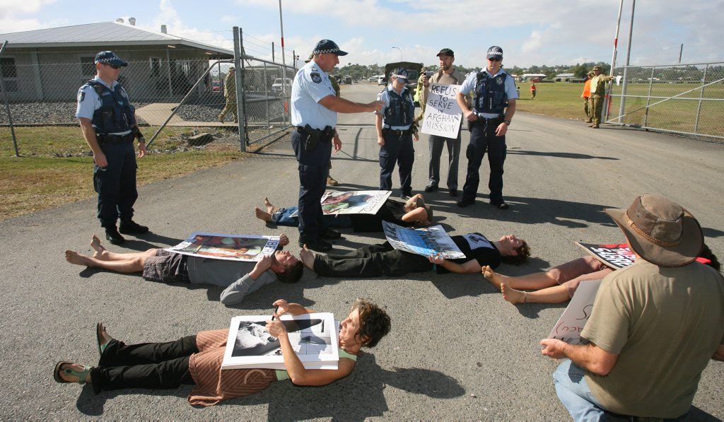 Anti-war protesters briefly blocked the entrance to Camp Rocky as Exercise Talisman Sabre ramps up. Photo: Chris Ison / The Morning Bulletin