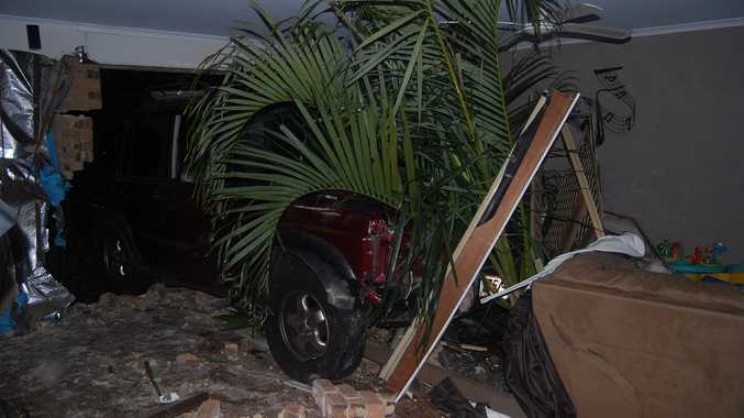 The four-wheel drive pushed palm trees from the front garden into the lounge room of the house in Pialba.