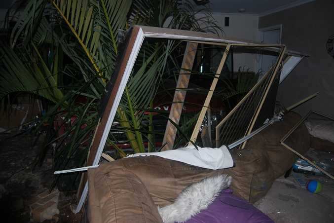 The window frame was pushed against the back of the lounge, which was pushed across the room, in the crash.