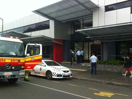 Authorities outside the Department of Child Safety building in Toowoomba.