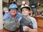 Ray Marxson, 66, with his grandson Jackson, 11, and some of the items on display at his sons Miners Arms Hotel.