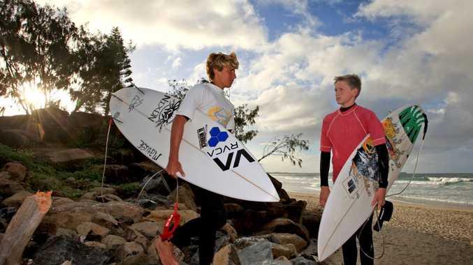 American student Davis Freud eyes of Kingscliff High Surfer Ruben Brimsmead before their heat at Kingscliff Beach.