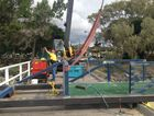 A crane is lifting a 17m steel walkway into place at the Urangan Pier.