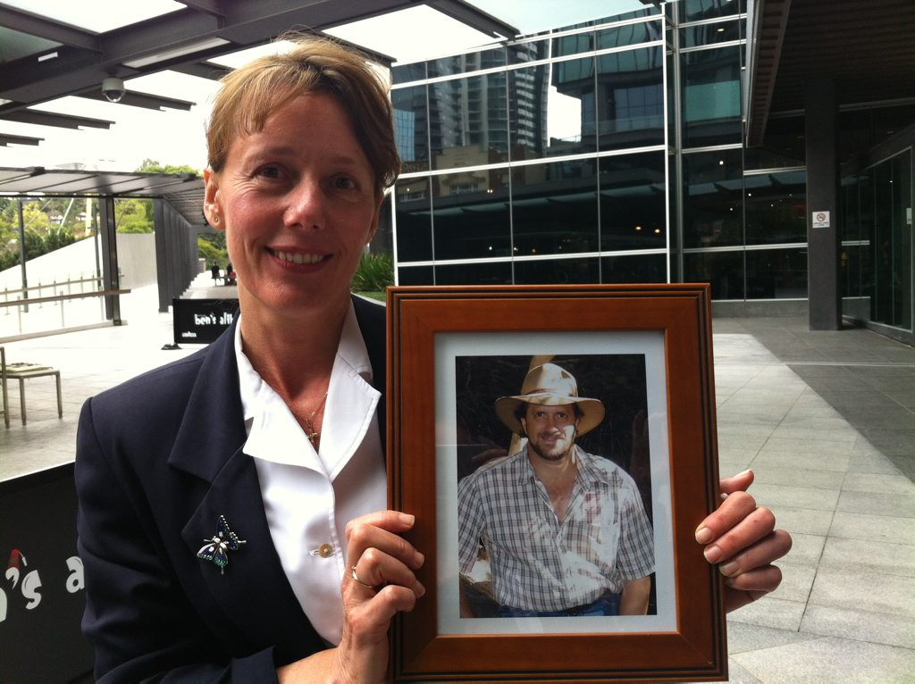 Wamuran's Andrea Mafliet, guidance officer at Woodford, with a photo of her partner Gavin Woods, who was deputy principal at Burpengary State School before taking his own life.