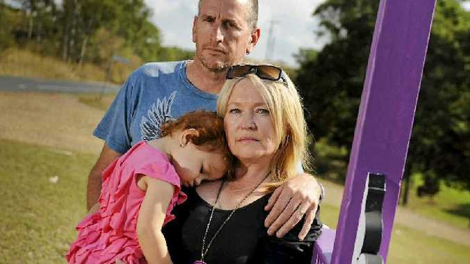Debbie and Garry Mason stand by a new a tribute to 19-month-old Tu Maia's mum Horotia Brennan, who was killed in a crash almost one year ago.