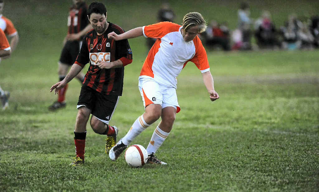 WRAPPED UP: Meteors' Cooper Lems dominates the ball in a match against Yaralla at Meteors Sports Ground, Gladstone.