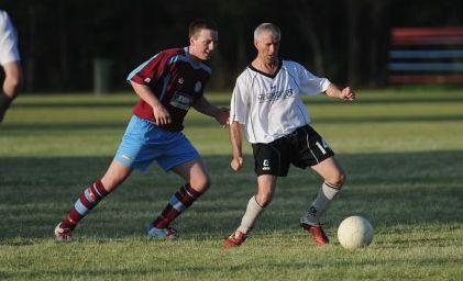 Doon Villa's Colin Bassett fends off a Gympie defender.