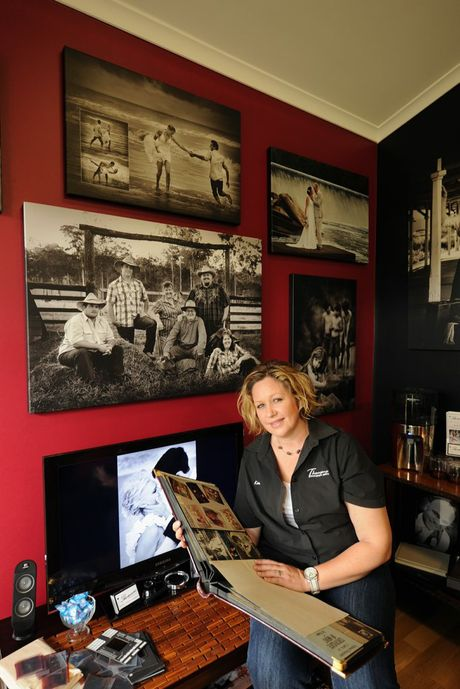 Kim Thomsen perusing an album of photos taken by her late father Wilson, who is her main inspiration.