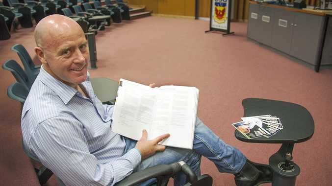 Fraser Coast councillor Darren Everard gets comfortable on one his former lecture chairs in the lead-up to Business on the Couch at USQ.