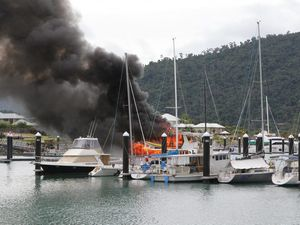 Boat destroyed by fire at Port of Airlie marina