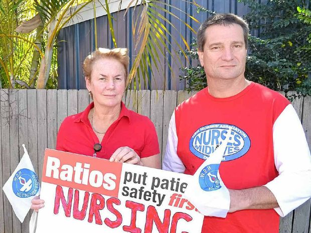 RUN OFF THEIR FEET: Striking nurses Paul Fletcher and Carol Henley outside yesterday's rally. Photo: Lachlan Thompson