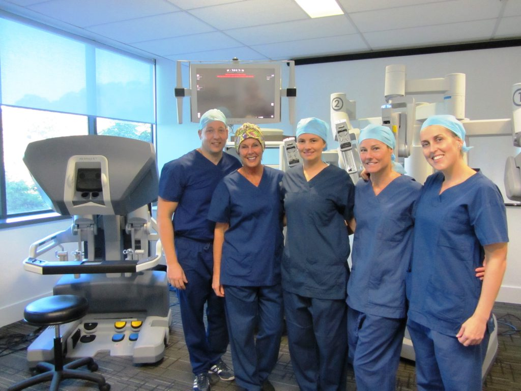 Dr Alistair Campbell and the urology theatre nursing staff.