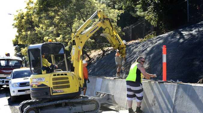 Work being done on the Landslip on the M1 near John Flynn Hospital.