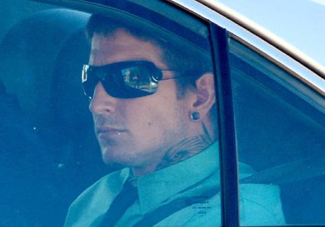 Luke Shayne Kister is driven into Mackay police station after being arrested for being an accessory after the fact in the murder of Timothy Pullen.