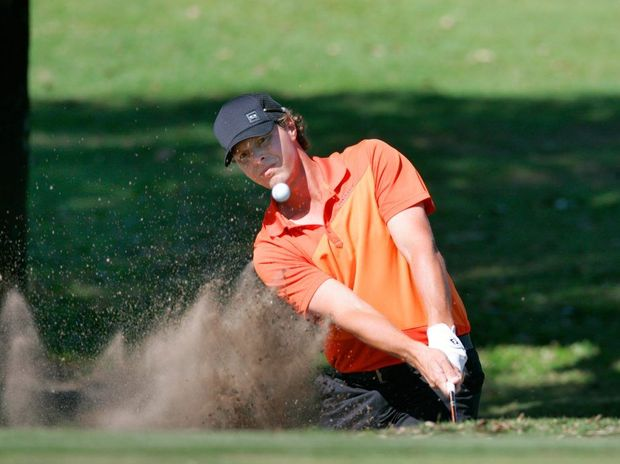 Justin Smith chips out of a bunker during play on Day One at the Capricorn Resort Pro-Am golf tournament. Photo: Chris Ison / The Morning Bulletin