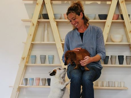 Claire Atkins of Pinky & Maurice Contemporary Ceramics pictured with her dogs, Pinky and Maurice at her studio in South Golden Beach.